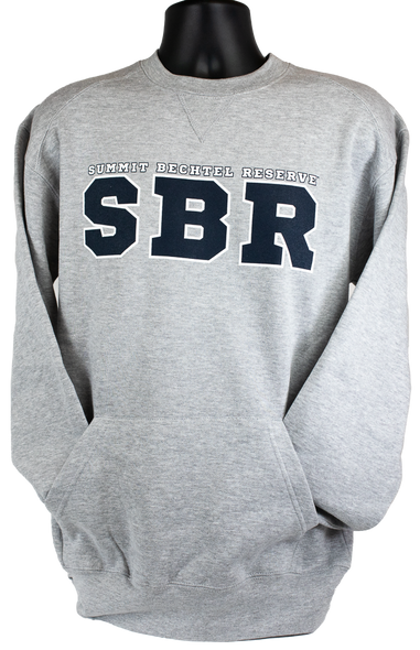 Heather gray Crew Sweatshirt with a kangaroo front pocket. Large navy blue lettering, SBR with the wording Summit Bechtel Reserve in smaller print located center chest.