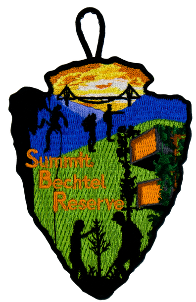 """arrowhead-shaped patch with silhouette depictions of various high adventure activities: on the left a repeller, on the bottom two people examining a tree, in the middle two people hiking. The top shows the side wings of the consol energy bridge in sillhouette over a yellow sky, and the bottom has a green background with the sustainability treehouse on the left. """"Summit Bechtel Reserve"""" lettering in the left-center"""