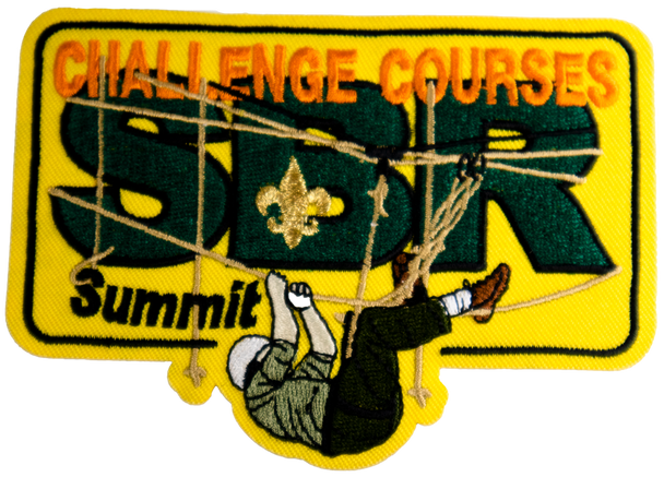 """rectangular yellow patch with dark green letters """"SBR"""" covered by orange letters """"challenge courses"""". On the bottom of the patch, a person climbing horizontally across ropes."""