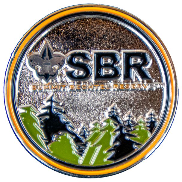 Front of SBR Commemorative Coin with Mountain Scene and SBR Typographic Logo