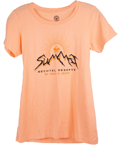 Ladies short sleeve tee in a soft orange color. Artwork in centered with wording; Summit in the center with the MM's representing mountains (black), there is a BSA logo above the mountains in the center of a sun and sunrays (soft orange), in small print wording Bechtel Reserve (black) and below that in smaller print is, Boy Scouts of America (soft orange).