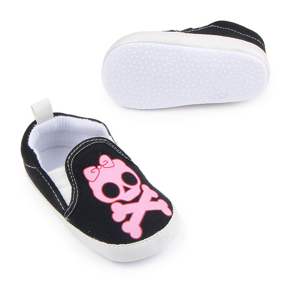 Pink skull baby girl shoes, baby girl skull and crossbones shoes, pirate baby girl shoes, rock and roll baby shoes, baby gift for cool new parents, badass baby shoes, pink skull shoes for infants, skull with pink bow canvas baby shoes, baby shoes with grippy bottoms.