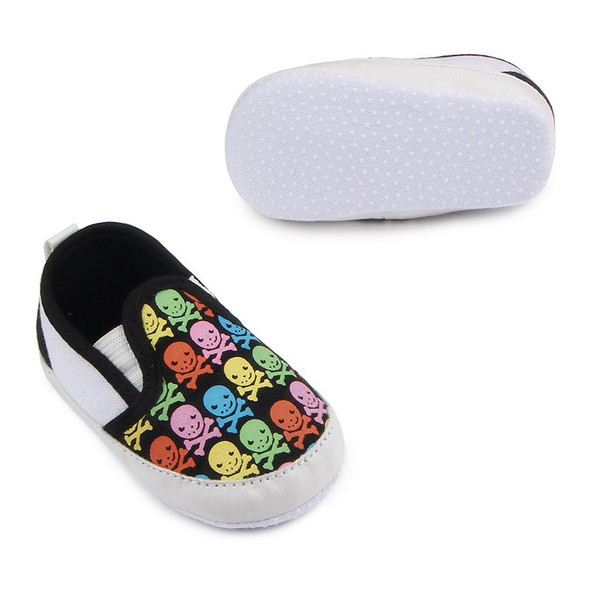 colorful skulls baby shoes, baby skull and crossbones shoes, pirate baby shoes, rock and roll baby shoes, baby gift for cool new parents, badass baby shoes, multi colored skull shoes for infants, skull canvas baby shoes, baby shoes with grippy bottoms