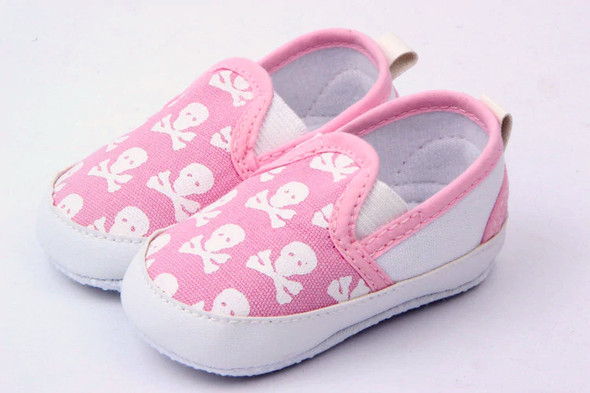 Pink skulls baby shoes, baby skull and crossbones shoes, pirate baby shoes, rock and roll baby shoes, baby gift for cool new parents, badass baby shoes, little girl skull shoes for infants, skull canvas baby shoes, cool baby shoes, side view