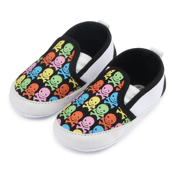 colorful skulls baby shoes, baby skull and crossbones shoes, pirate baby shoes, rock and roll baby shoes, baby gift for cool new parents, badass baby shoes, multi colored skull shoes for infants, skull canvas baby shoes