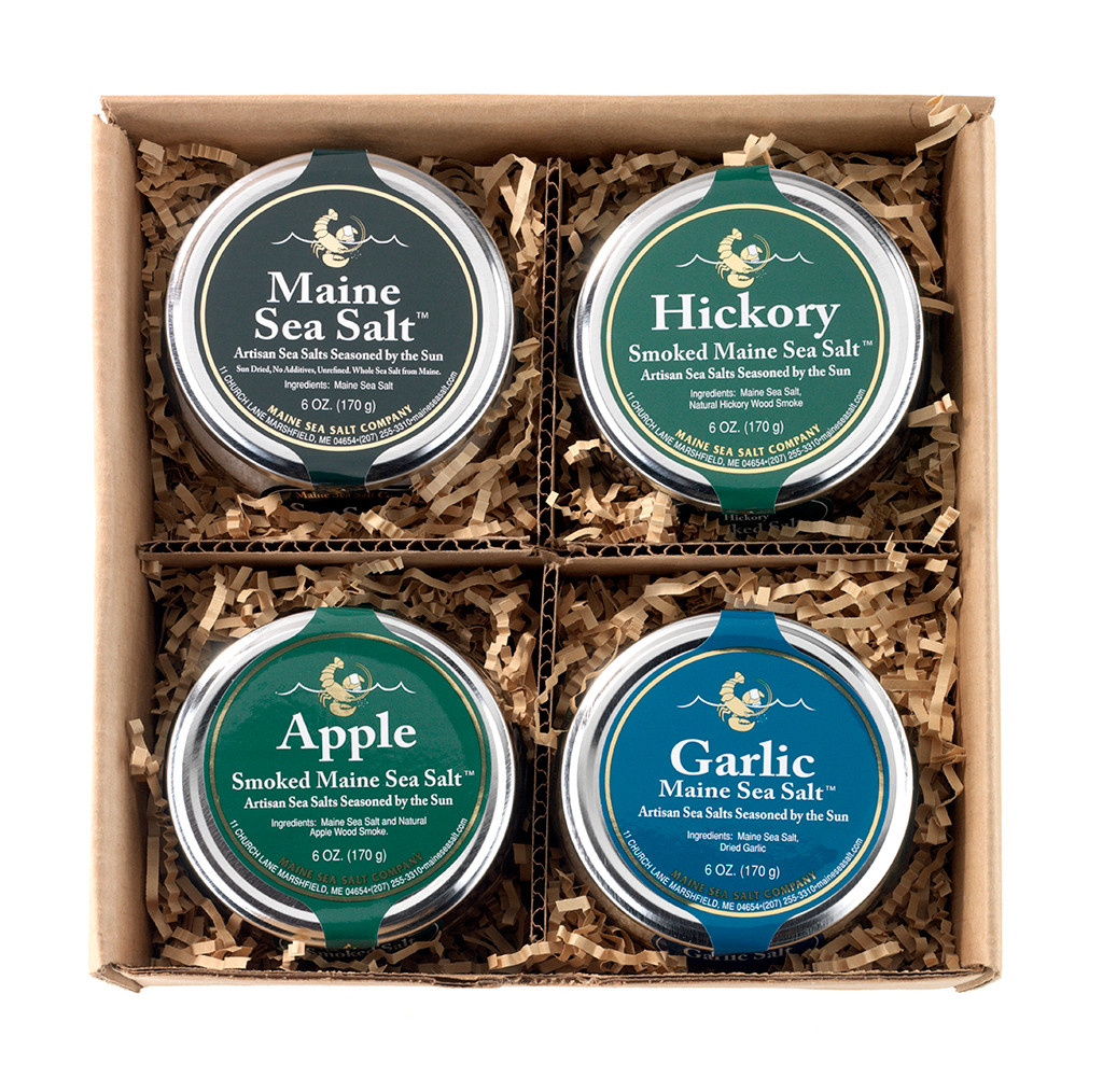 Maine Natural salt sampler, four of our most popular salts, Natural, Roasted Garlic, Apple smoked salt and Hickory smoked salt. 6oz gift jar.