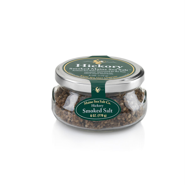 Hickory Smoked Maine Natural Sea Salt, shown in a 6 oz glass gift jar.  Smoked over a Hickory fire for a clean smoky taste.Use for cooking, seasoning, at the table. Hickory Smoked Maine Sea Salt.