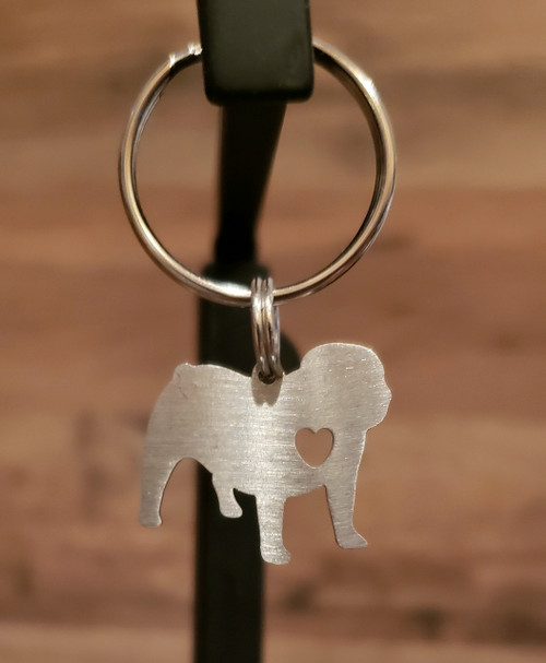 A Silver metal bulldog cut out with a cute love heart to show your love for the breed. Looks great on a keyfob You can add this charm to either a small or large collar order or a key fob but it can not be order separately .  The charm can not be attached to a harness or leash. Please state in the comments section at the checkout, what charm you want attached to what collar or key fob... thanks