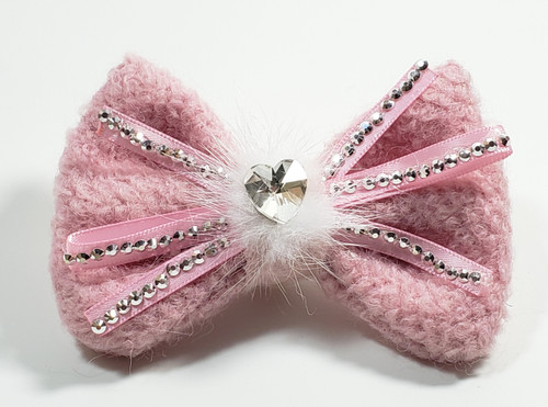 These bow ties can be attached to any of our existing collars. A pretty woolen pink bow with Diamond like embellishments and feathers. A real eye catcher. It has a velcro loop at the back that can be added to any collar or harness for a very stylish look.