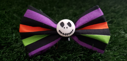 Add a little Spook to your Halloween this season. Velcro loop on the back that can be added to any existing collar. Cute Jack Skellington button to give that extra pop.
