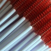 Red and white handle mascara brushes.