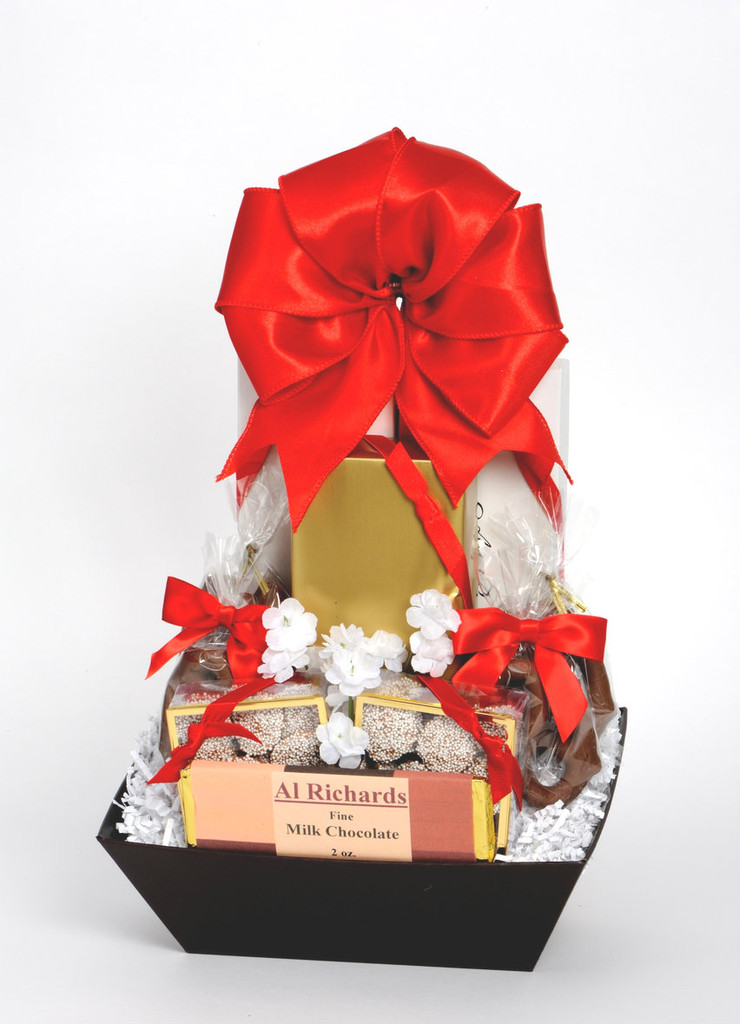 Assorted Chocolates, Chocolate Covered: Raspberry Jellies, Pretzels, Crackers, Non-pareils and Chocolate Bar.  Net Weight 2 pounds.  All our baskets are finished with shrinkwrap and a beautiful handmade bow.