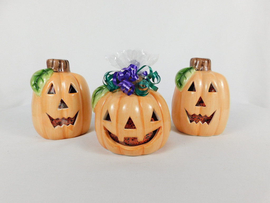 This Ceramic Pumpkin Candle Holder contains, 6oz. chocolate covered mini pretzel.