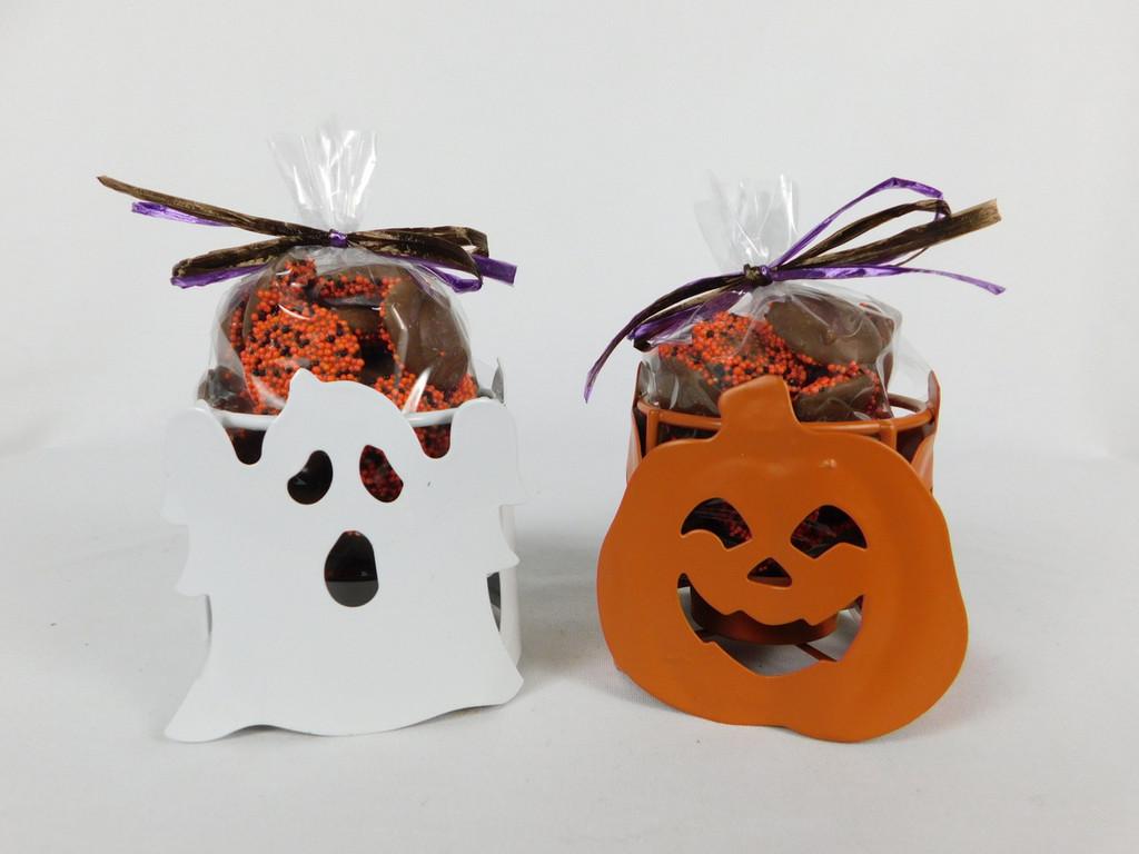 This Pumpkin and Gosht Metal Candle Holder contains, 6oz. non-pareils.