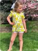 Short sleeves with flutters, scoop back, peplum length a-line skirt