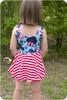 Sleeveless, scoop back, peplum length twirl skirt