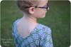Long sleeves, scoop back, knee-length gathered skirt