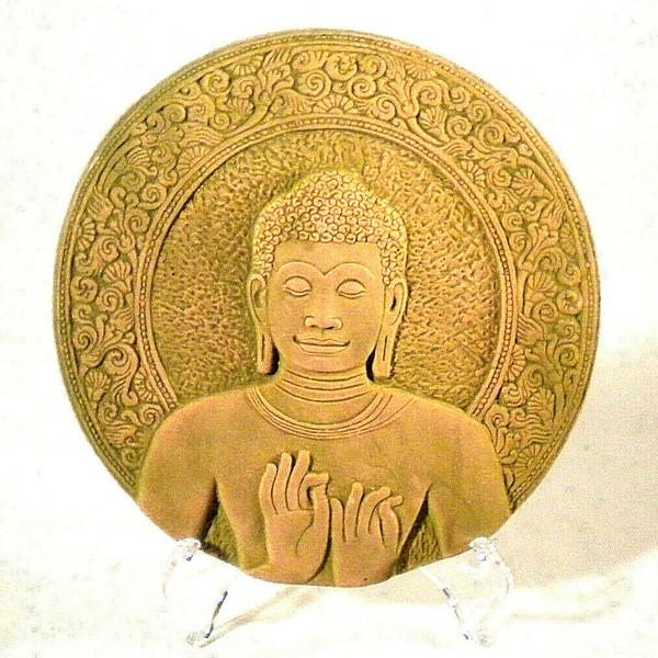 Buddha's bust. Dharmacakra Mudra