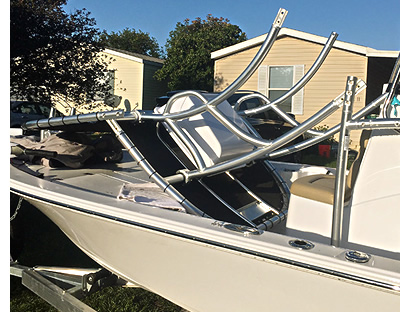 Photo shows a boat t-top folded down
