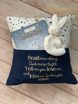 Navy pillow, moons and stars style.  Such a great gift, fill the pocket with a book and binkie holder to create the best gift.  By Wicked Stitches Gifts.