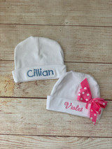 Embroidered baby name hats by Wicked Stitches Gifts.  Cotton jersey infant cap personalized with baby's name.