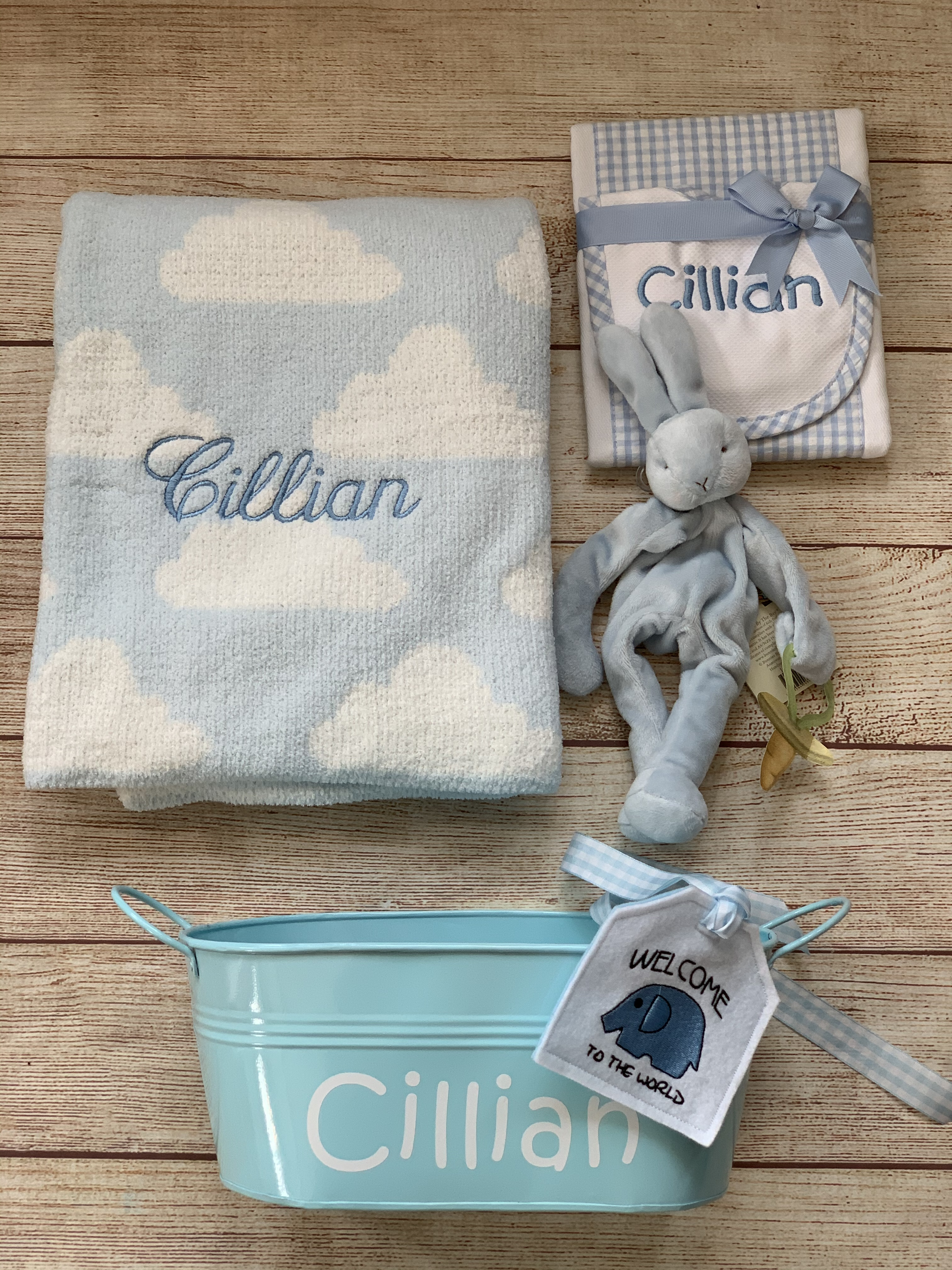 Add a bib & burp cloth, a binkie buddy and upgrade your gift wrap to make the most awesome baby gift ever. It's easy at Wicked Stitches Gifts!