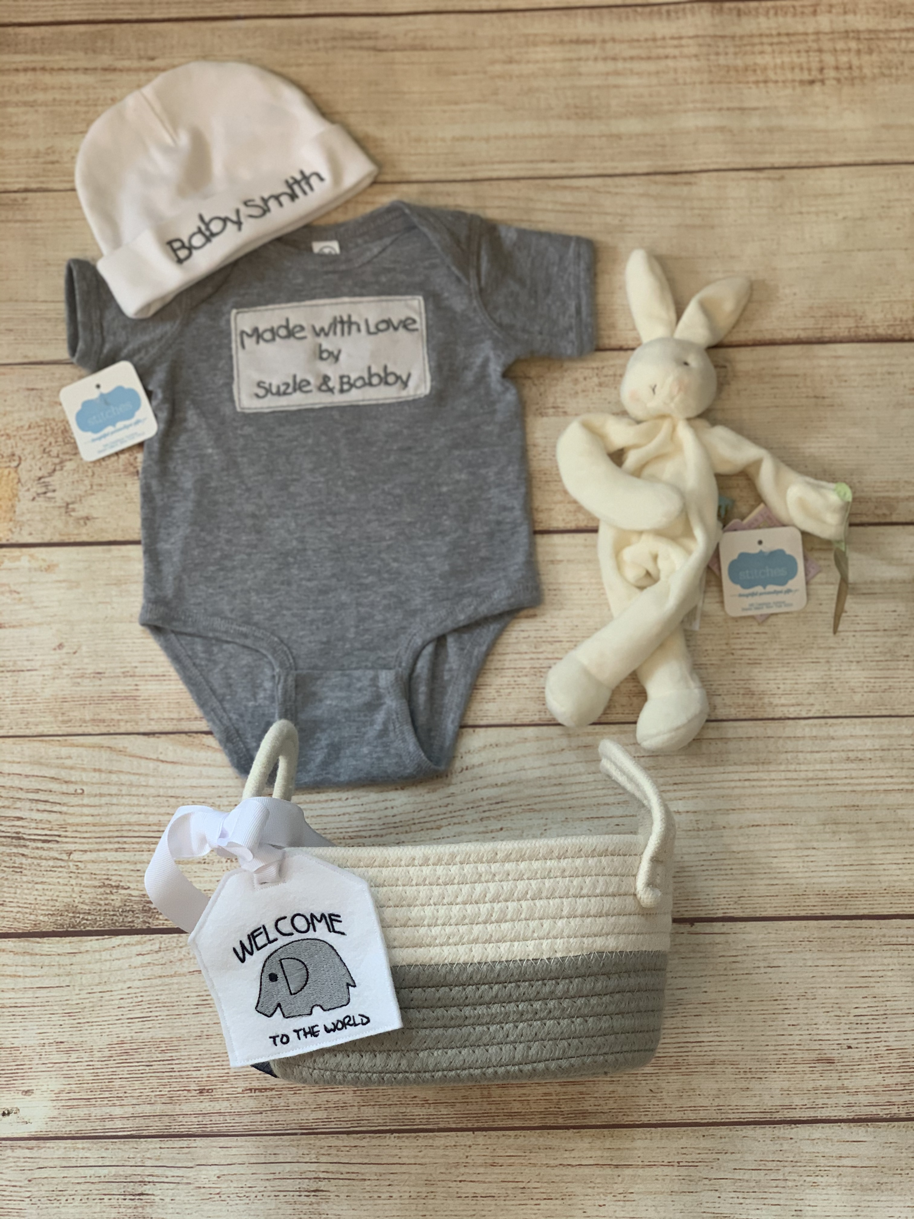Make it extra special. Add a binkie buddy and a small cotton storage basket and tag.  Wicked Stitches Gifts.