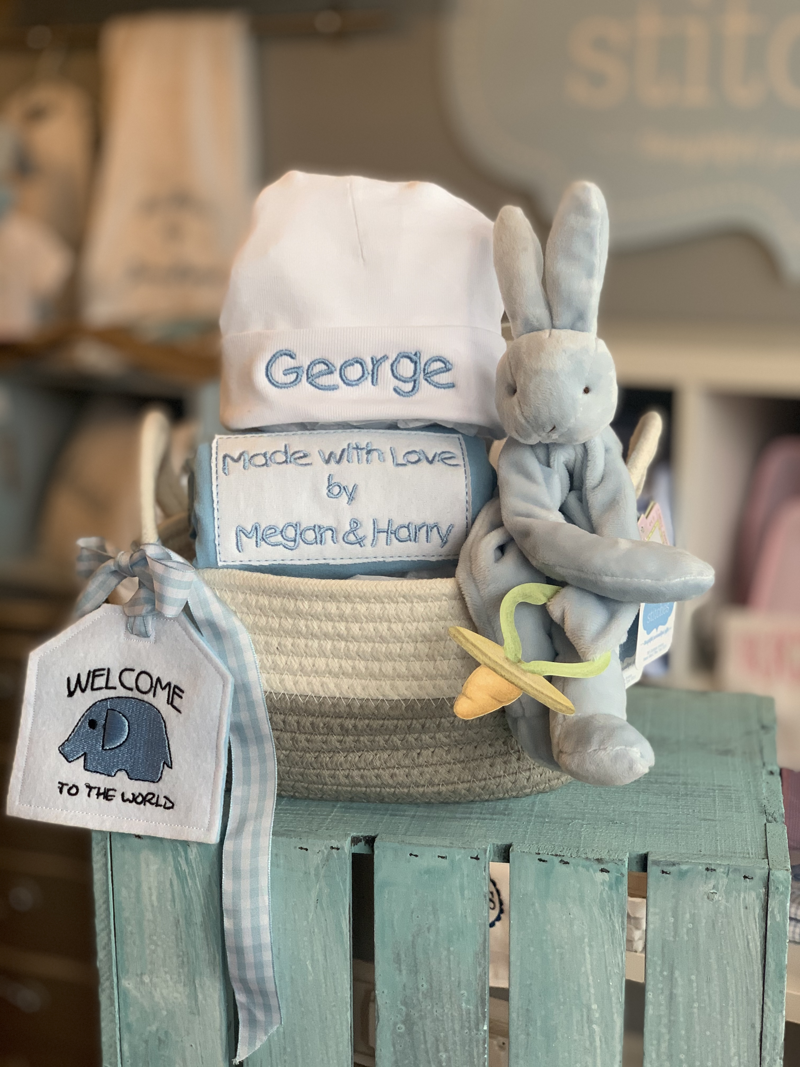 Wrapped and ready Made with Love Onesie and Hat by Wicked Stitches Gifts.  We love to wrap and it shows!  Order your upgrade wrap today. Add ons: Binkie Buddy, Storage Basket, Tag