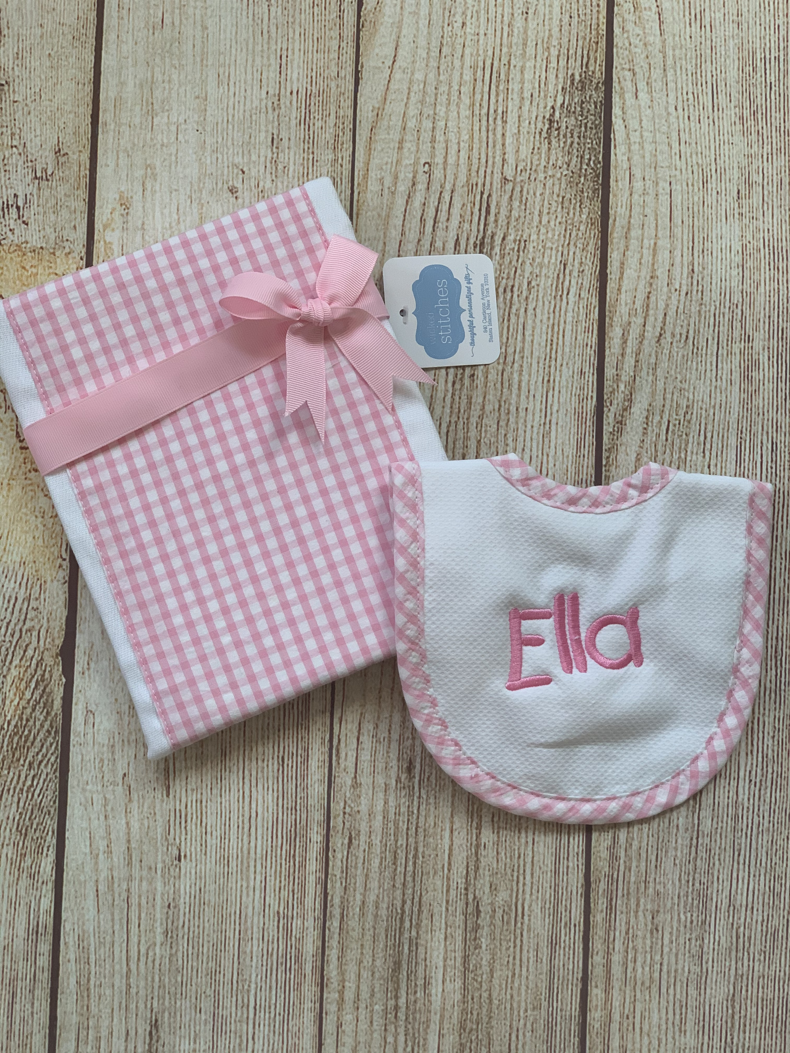 Great new baby gift, it comes wrapped up in clear cellophane or consider upgrading your wrap.  Newborn Feeder Bib and Burp Cloth set by Wicked Stitches Gifts