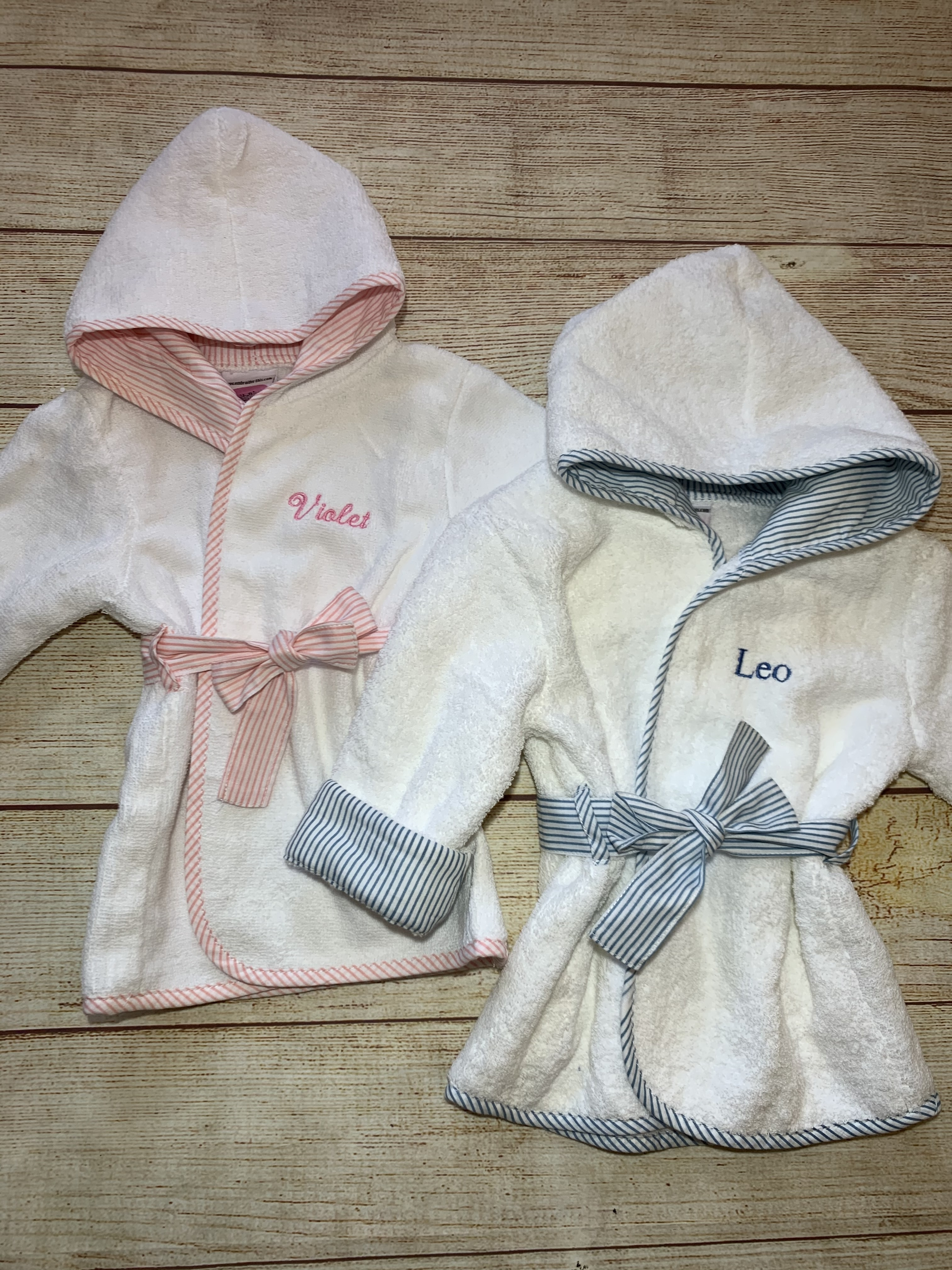 Bath time fun, wrap the baby up in our thirsty robes.  Pink or blue trim, embroidered name included  by Wicked Stitches Gifts