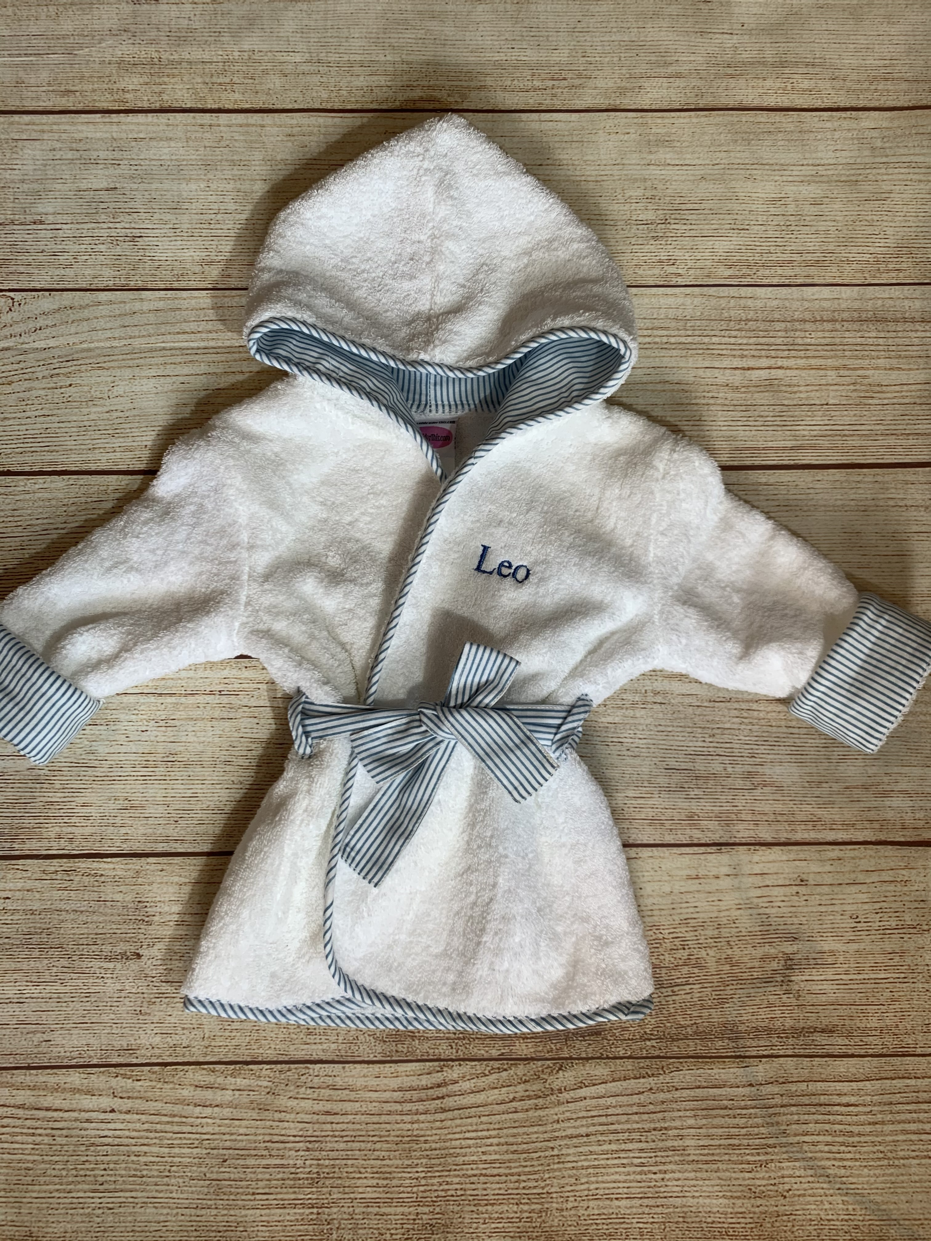 Wrap him up in a blue Trim Baby Robe by Wicked Stitches Gifts.
