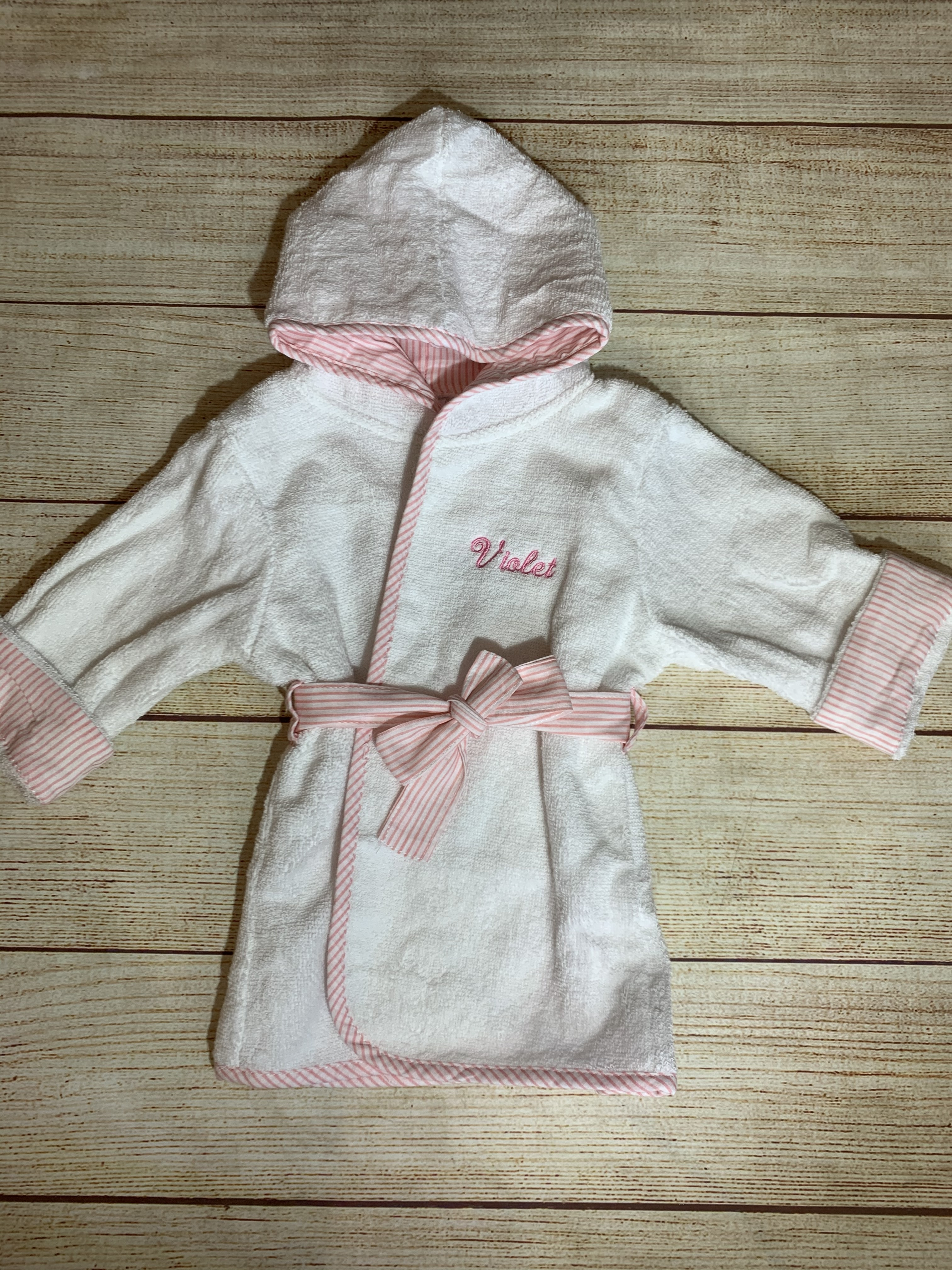 Wrap her up in a Pink Trim Baby Robe by Wicked Stitches Gifts
