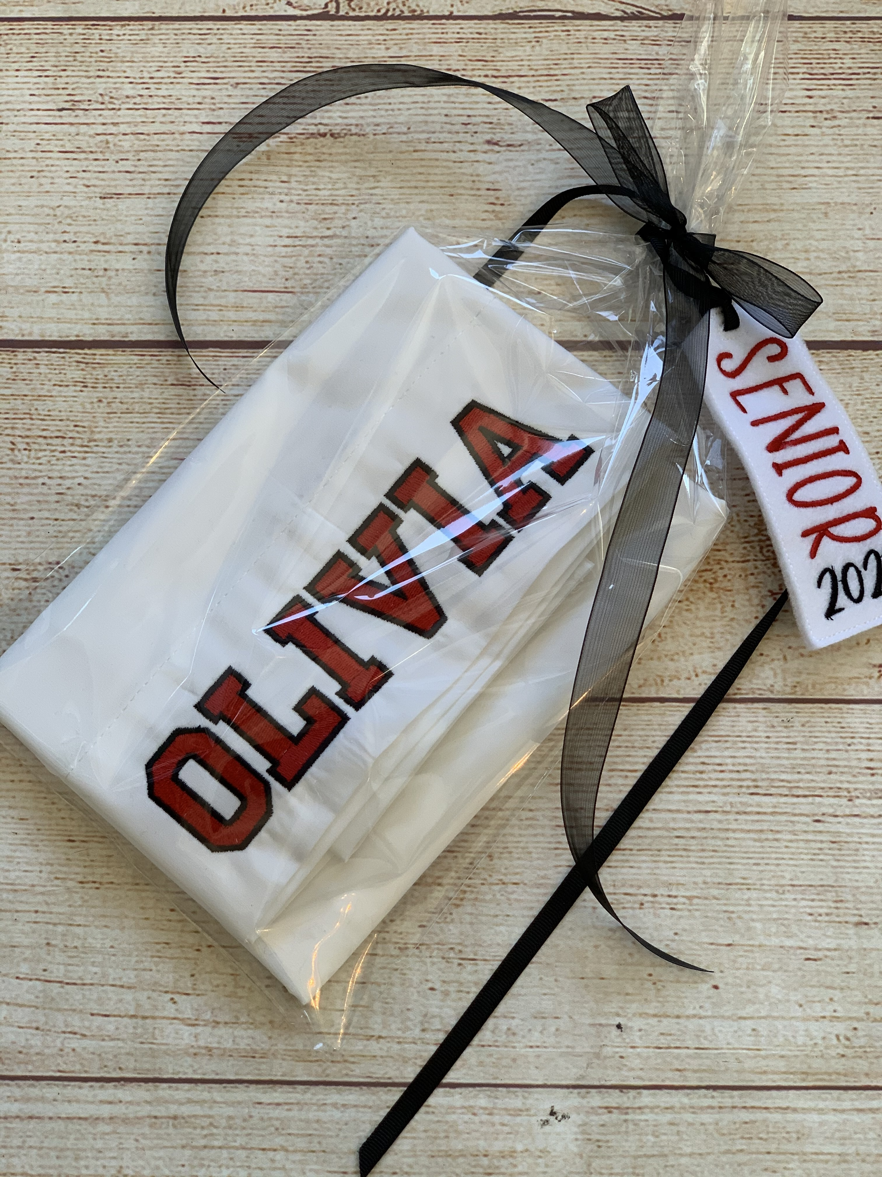 College Pillowcase wrapped in clear cellophane with an exclusive gift tag.  By Wicked Stitches Gifts.