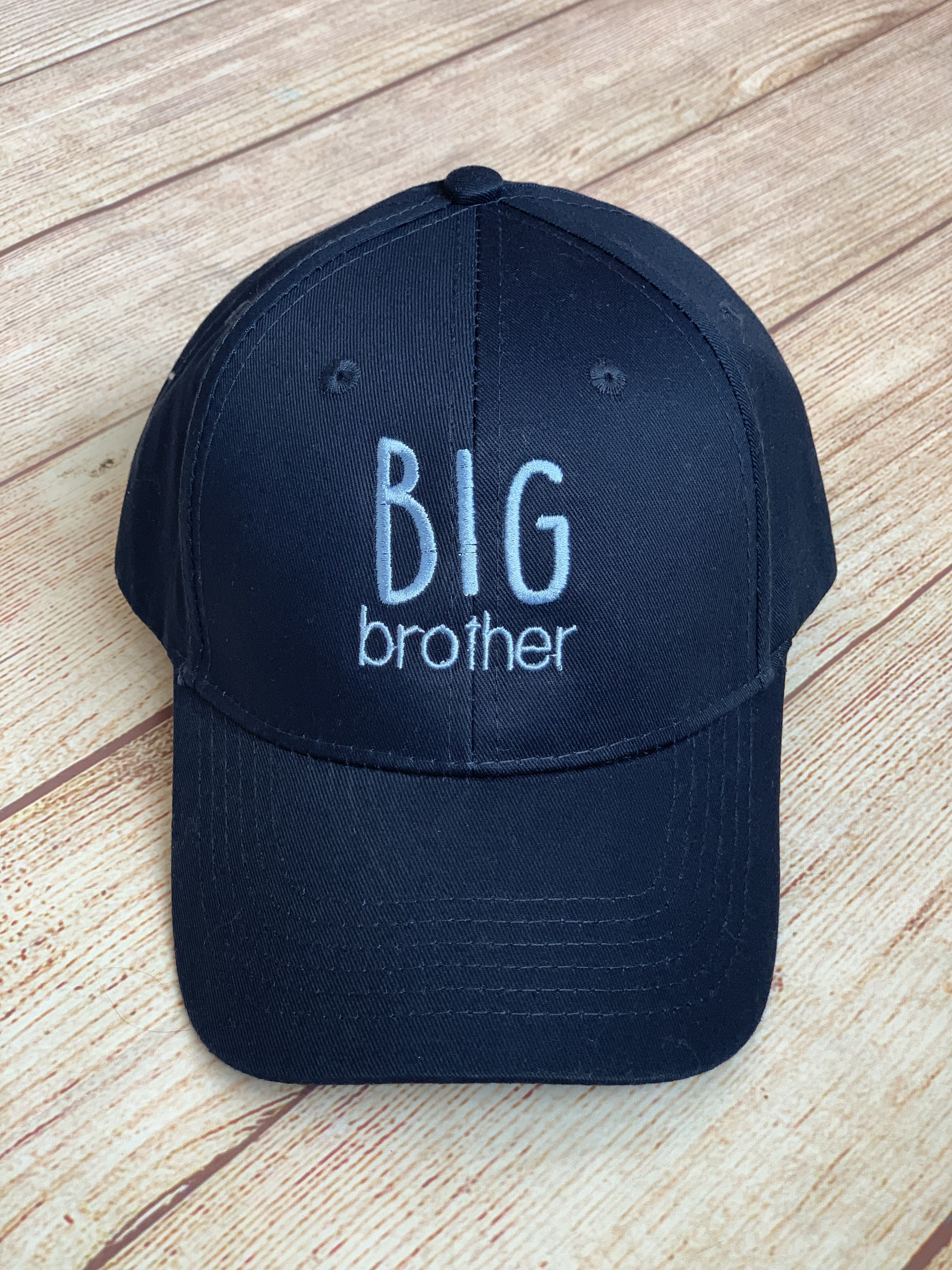 Bring a little gift for the big brother. It's adjustable - no size needed!