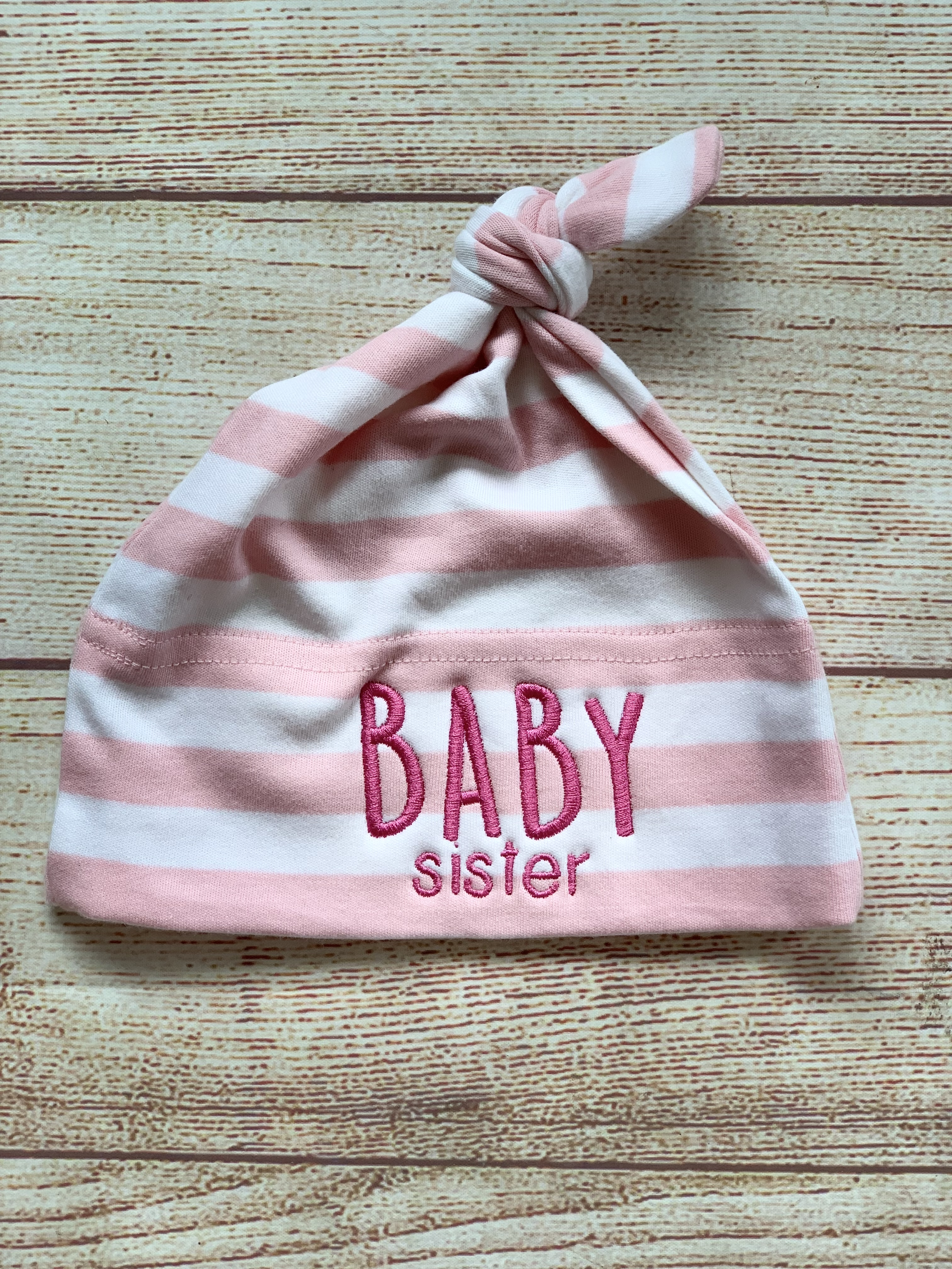 Baby Sister knot cap is the perfect little gift for the perfect little sister by Wicked Stitches Gifts