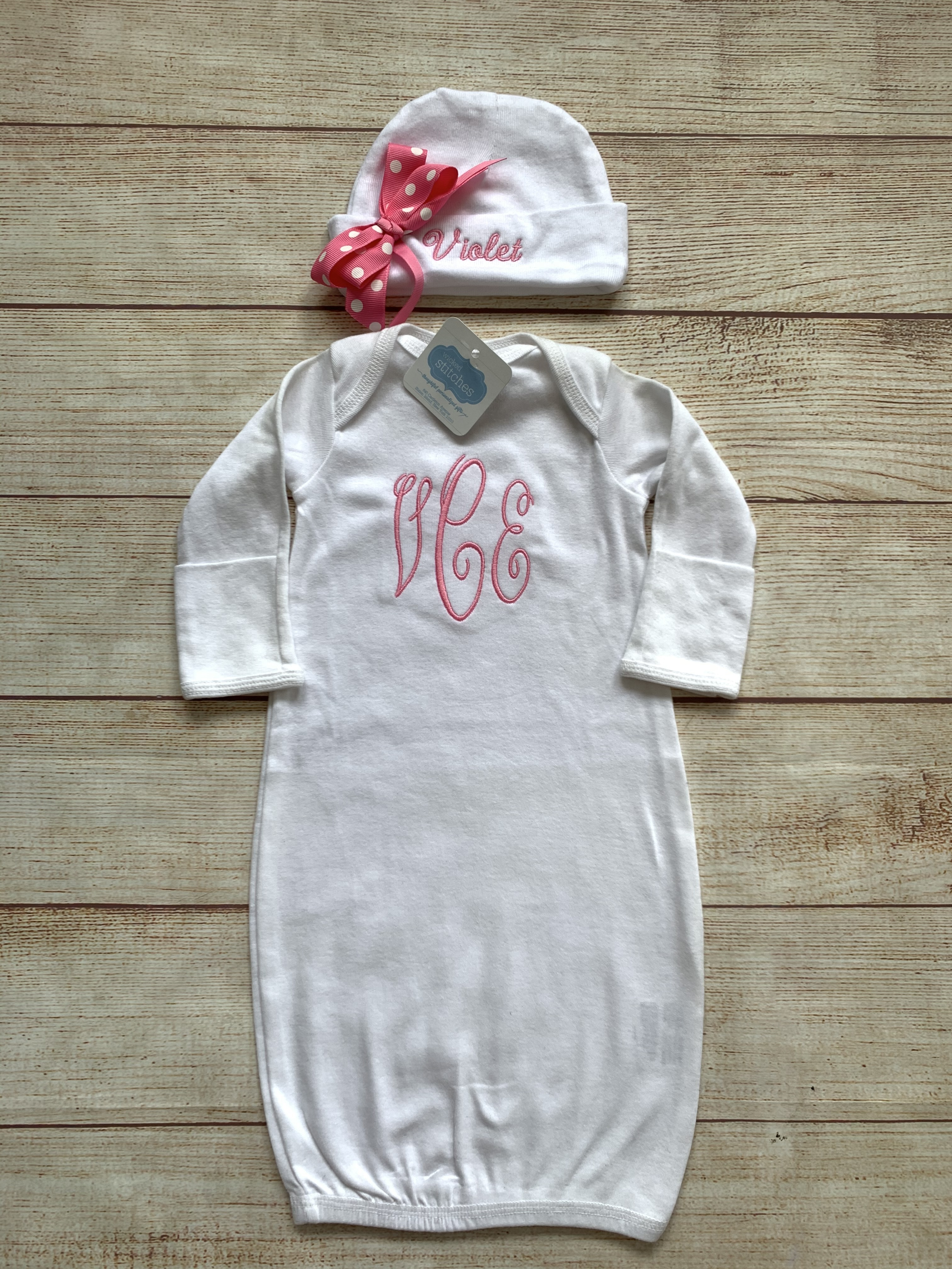 Monogram in script with matching font on cap.  Monogram initials are shown first name, last name, middle name.  Pink thread for script monogram.