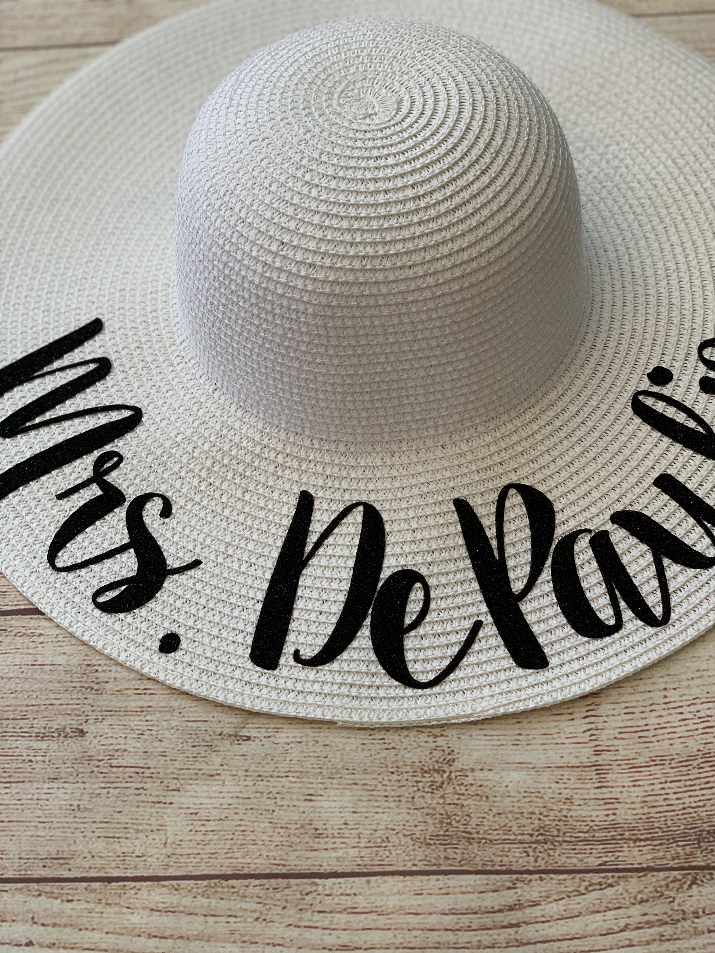 White hat with black glitter lettering. Wicked Stitches Gifts Honeymoon Hat