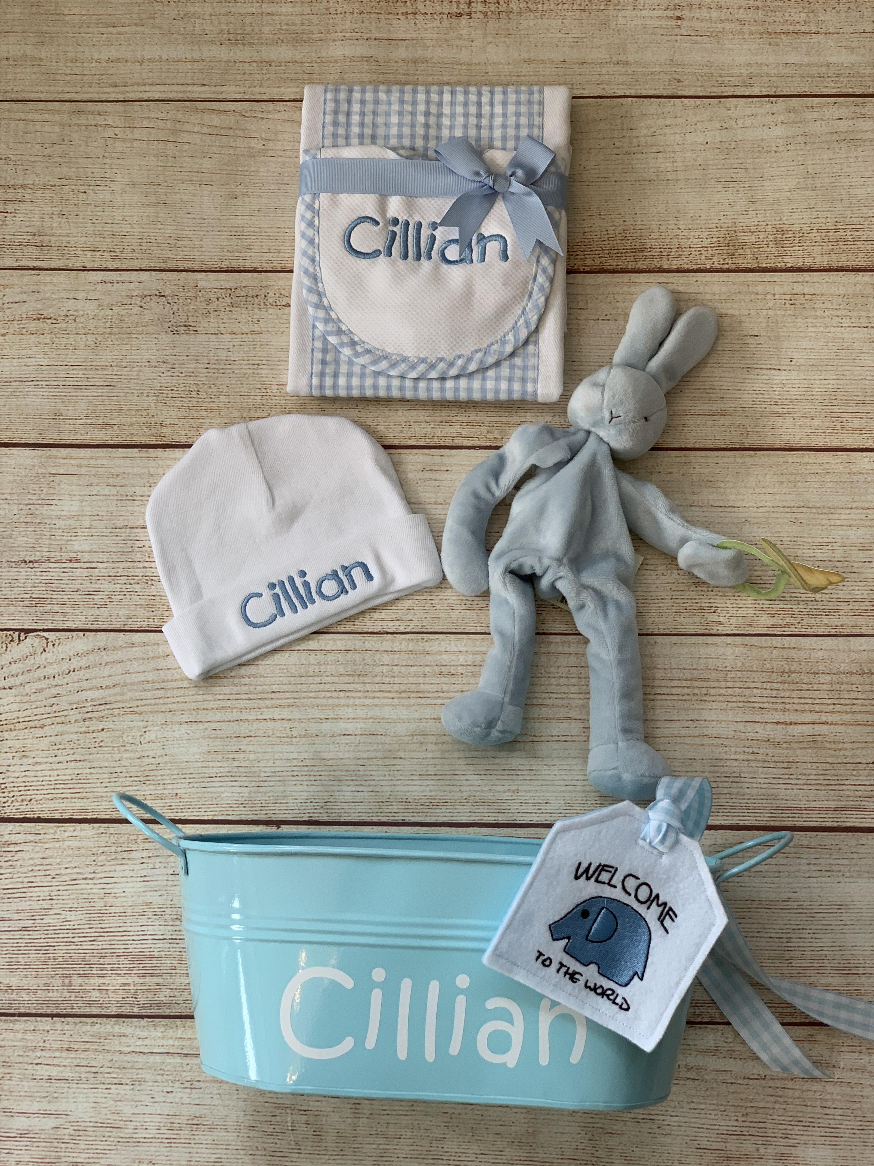 Add bib and burp cloth, binkie buddy,  gift tag and personalized tin!
