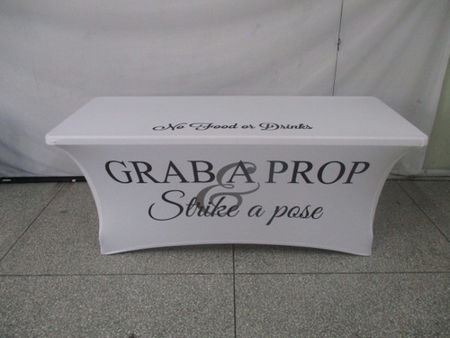 6ft Spandex Fabric Table Cover with Zipper in back - all white with black lettering | PB Backdrops
