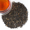 This very characteristic black tea comes from the high regions of Yunnan. Our Golden Tip Yunnan (also known as Dian Hong) is from organic production and has a well worked leaf with golden brown tips. The flavor is sweetish-spicy and softly earthy, soft round cup dark and strong and will not taste bitter when over-steeped. If anything, there is a underlying sweetness that deepens the more it is steeped.