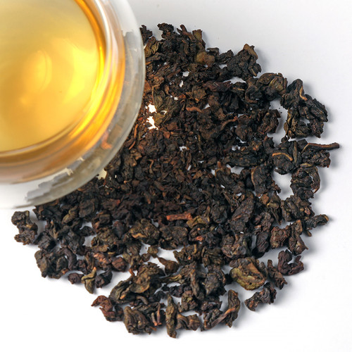 China Milky Oolong is an unusual tea from the Fujian Provence in China. Flavoring is added to the fresh tea leaves at origin giving the tea sweetish flavor reminiscent of milk Immediately after withering the still moist leaves are heated shortly in milk water steam, which conserves the pretty, lightly olive-green leaf and cup color and invokes the distinctive creamy scent and taste. This is one of our biggest sellers in the oolong category. Milky Oolong is known for its creamy flavors but only proper brewing techniques will bring out those notes.  Lower temperatures produce cream notes; higher temperatures bring out more floral qualities. Oolongs differ from green, black and white teas by the method of processing and are the most labor intensive tea to produce.   Brew tea at 180º - steep for 2 minutes. This tea lends itself to multiple infusions; for multiple infusions, let the tea steep for approximately 15 seconds longer on each subsequent infusion.