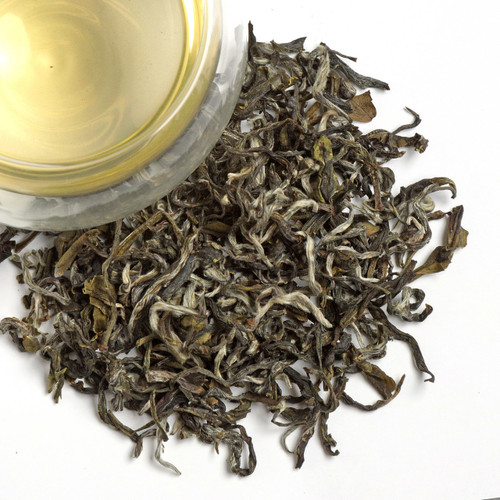 White Monkey is a Chinese green tea that grows along the slopes of the Taimu Mountains in Fujian Province. A tea with an extraordinary appearance and silvery tips. It is often mistaken for a white tea due to its name, appearance and mild flavor. The young leaves and unopened buds are carefully gathered and processed, a few days a year. exclusively by hand. It produces a warm colored cup, fresh and subtly seaweedy aroma infused with delicate sweetness and a slightly dry finish. A classic Fujian specialty!  1 tsp per cup steep at 180 for 2-3 minutes.