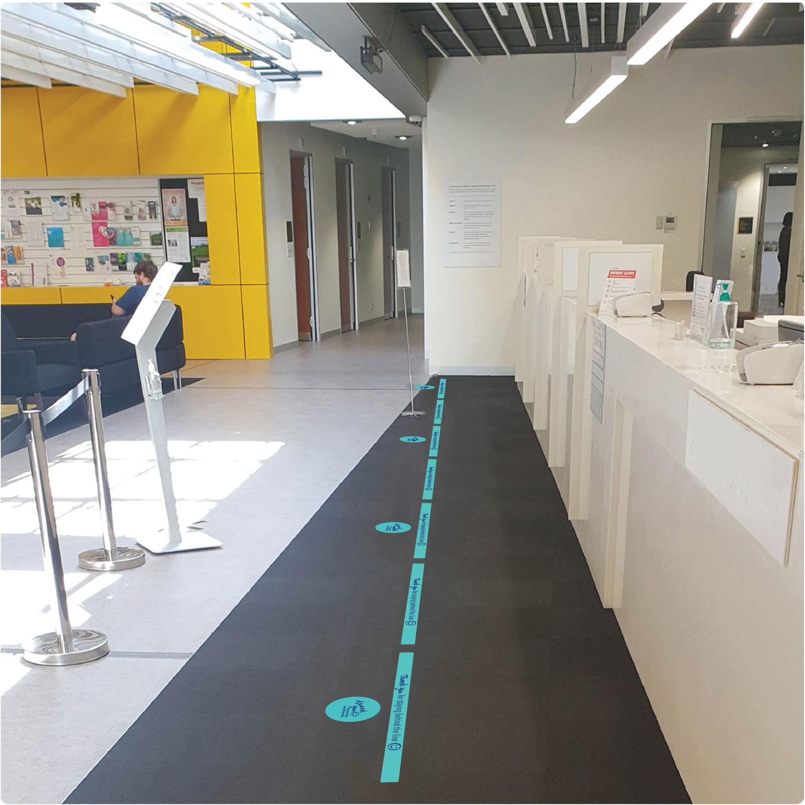 social distancing floor sticker for carpet, 2 lines, teal, photo Self-adhesive Corona virus floor sticker to help social distancing.
