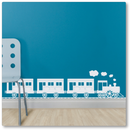 Our large steam train rides the skirting boards of your room all day with steam puffing out his stack! Shown here in white on a blue wall.