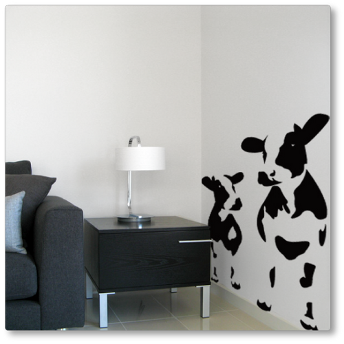 This 'mad cows' vinyl wall decal makes bold use of negative space to create a fun feature wall with two cows. Shown in black on the wall.