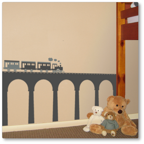 Our steam train with arched bridge is perfect for the train enthusiast in your family. Shown here in light grey and dark grey on a tan wall.