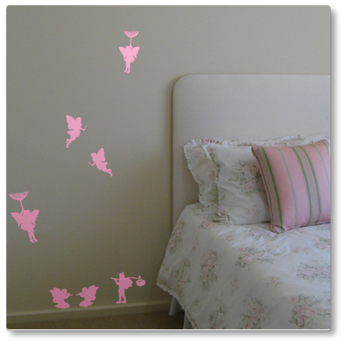 Our whimsical fairies set contains seven fairies, four flying, two seated and one standing. Shown here on a neutral wall in carnation pink.