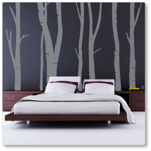 This designer feature wall decal of winter birch will make any room amazing. Shown here looking fantastic on a bedroom wall.