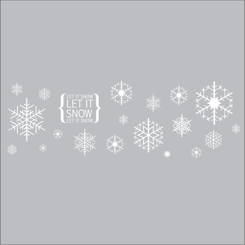 A HUGE decal featuring snowflakes, the text 'let it snow' and a sun. Create an amazing feature wall this Christmas! White on grey.