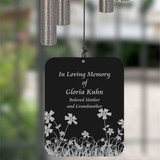 Back of wind chime sail is personalized with name and dates